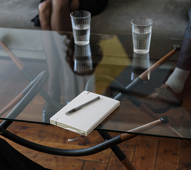 Tablet and Pen on table in front of couple