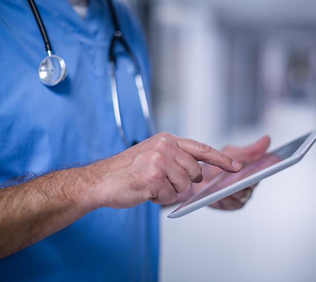 Healthcare worker holding iPad